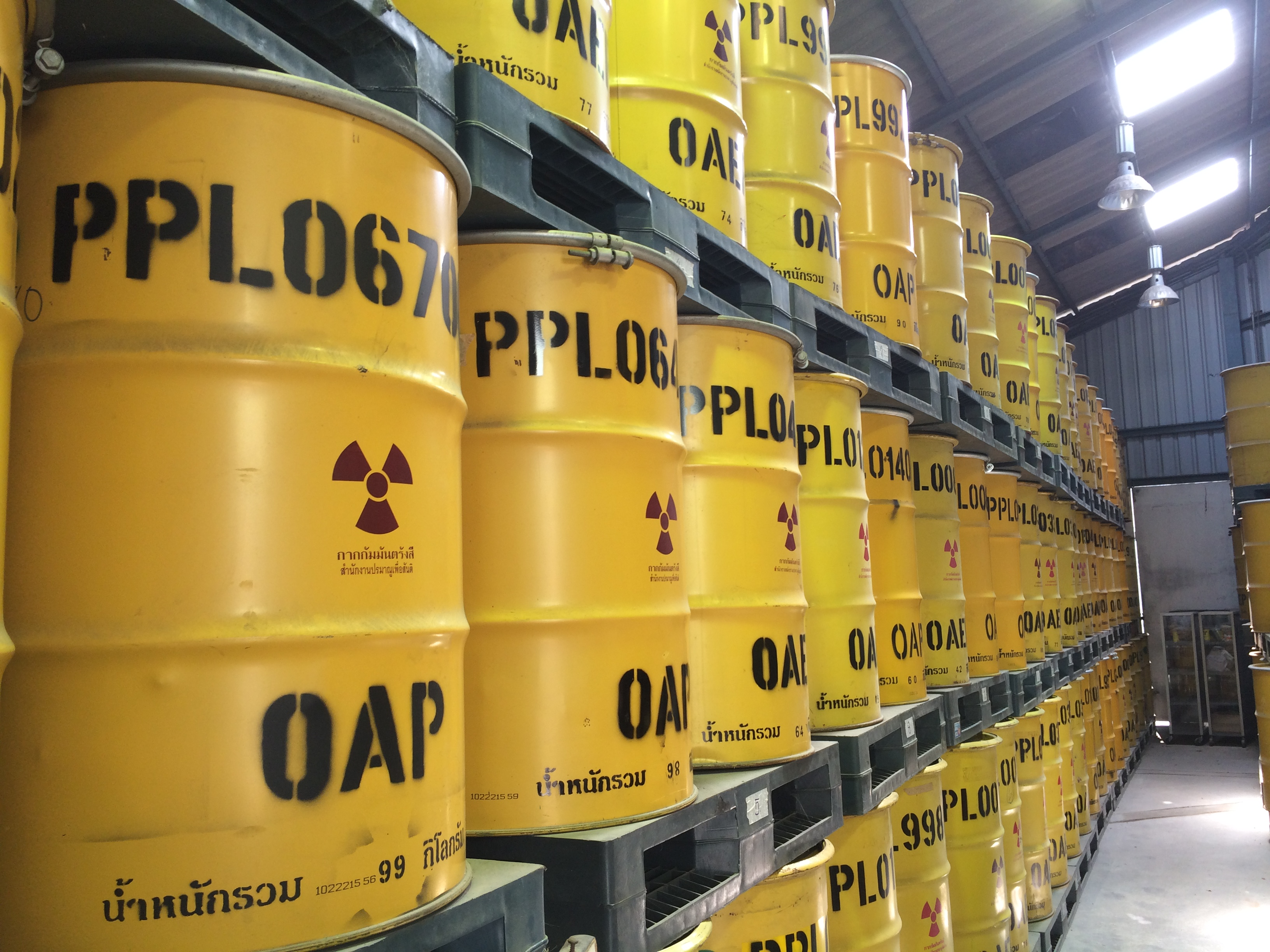 Rows of metal barrels containing nuclear waste